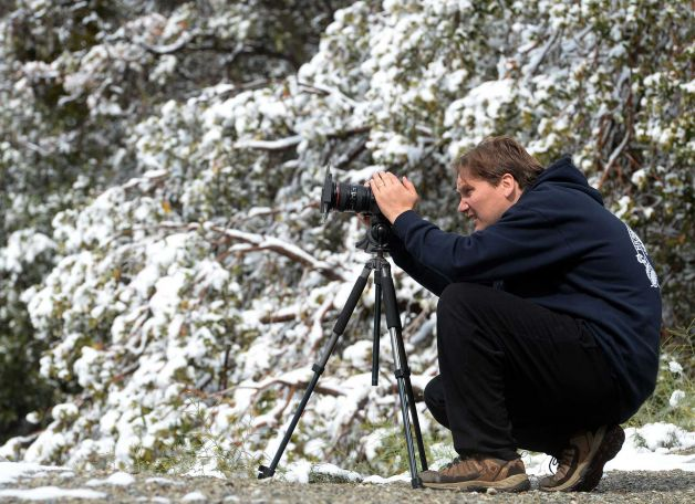 photographer in snow cover mountain